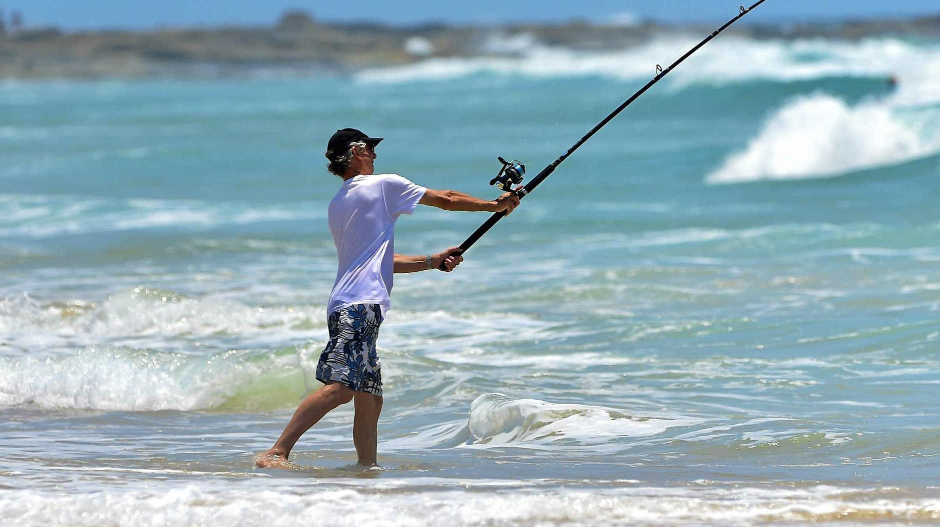 NEW LAWS: A fisherman is seen catching a snag on Point Cartwright.