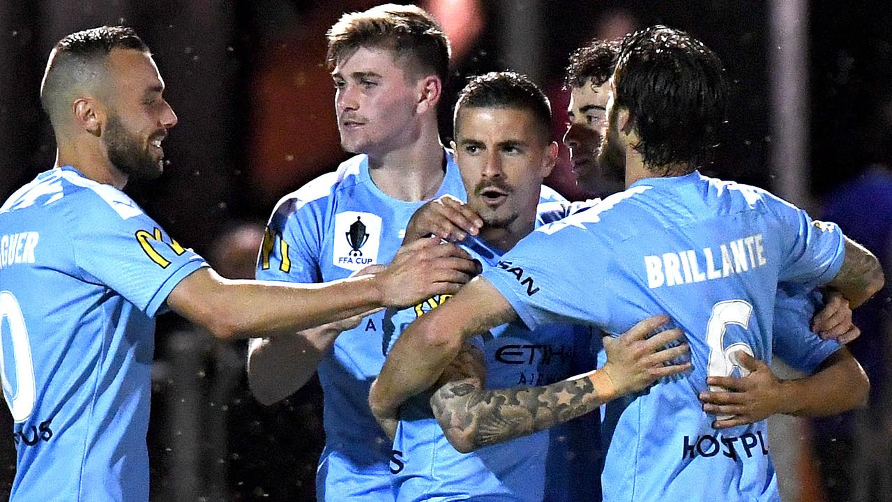 Melbourne City players congratulate striker Jamie Maclaren (centre) after he scored against Brisbane Strikers on Tuesday night. Picture: Getty Images