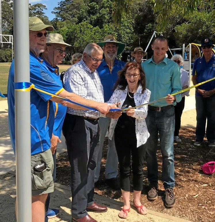 RIBBON CUTTING: Lismore MP Janelle Saffin gets a helping hand from former MP Thomas George as Goonellabah Rotarians look on.