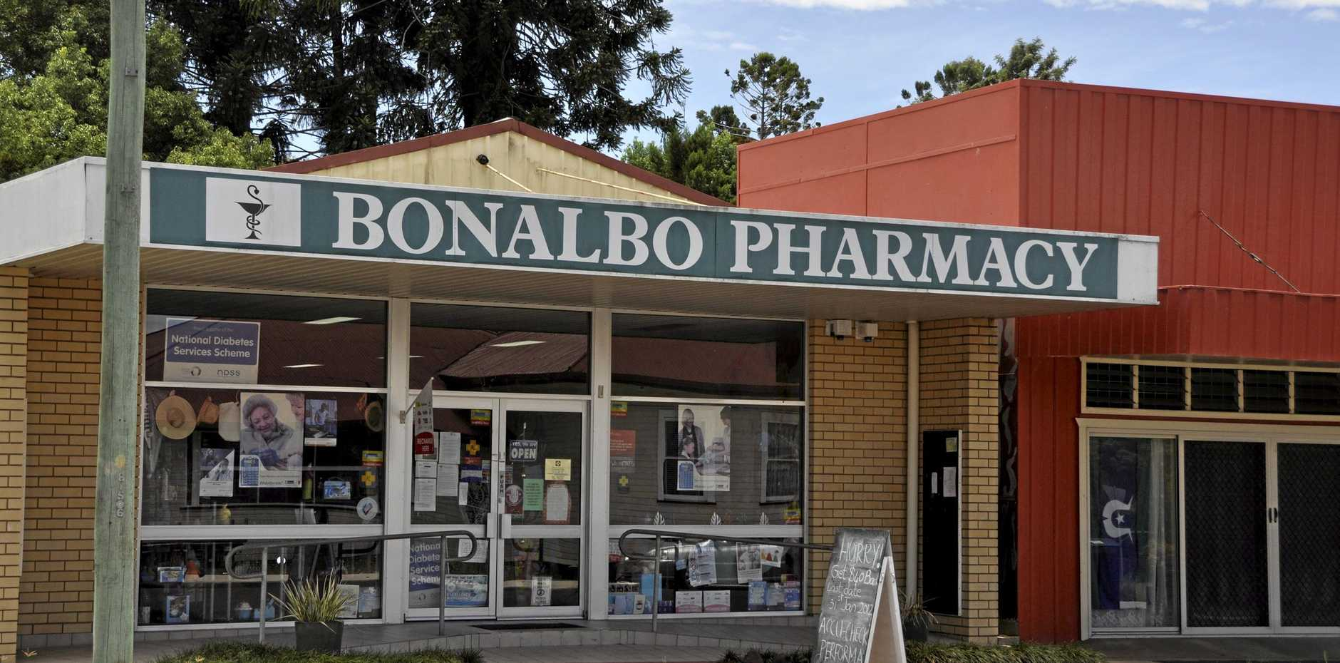 A man has been accused of robbing Bonalbo Pharmacy while armed with a syringe.
