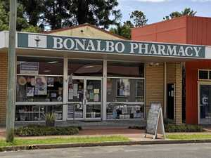 Pharmacy robbery accused remains under guard in hospital
