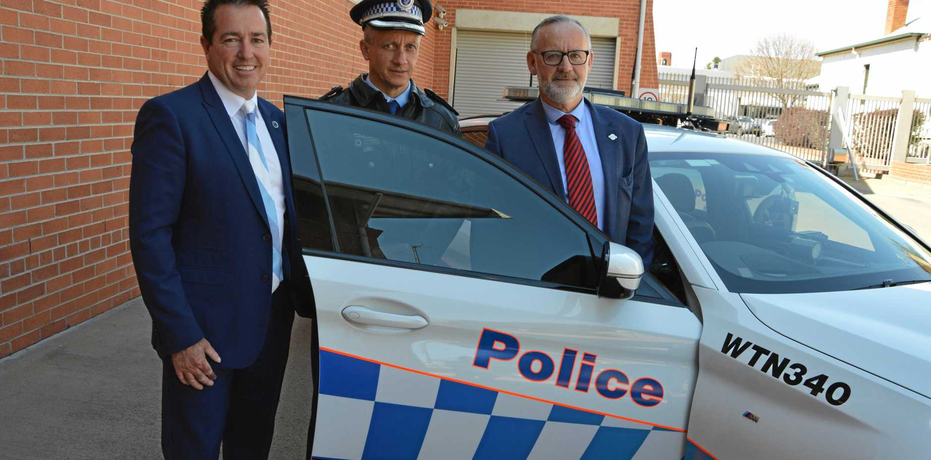 SLOW DOWN: Minister for Regional Transport and Roads Paul Toole with Traffic and Highway Patrol Regional Commander Superintendent Paul Glinn, and Centre for Road Safety executive director Bernard Carlon.