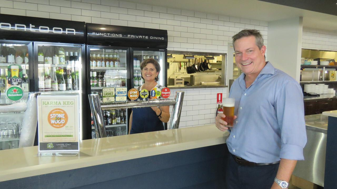 FEEL-GOOD BEER: Scott Armstrong is served up a cold one by Trudiene Haddad.