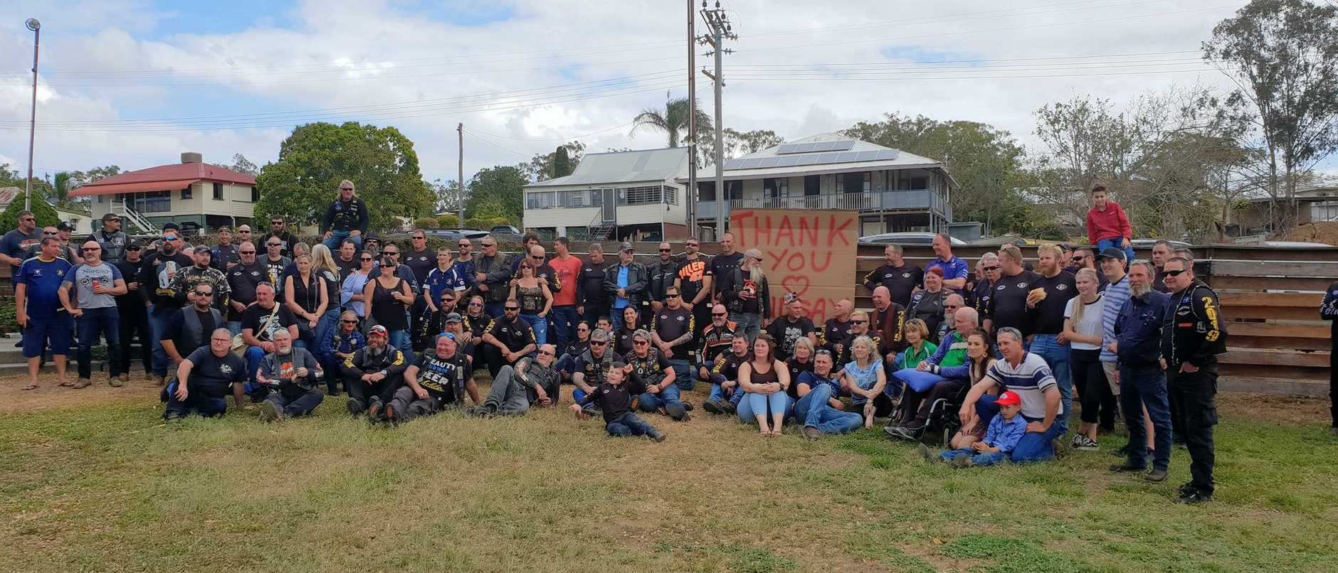 RIDING FOR LINDSAY: Riders in the Daly's Gym motorcycle fundraising ride on September 21 stand with a sign made by Lindsay's dad Peter Smith to thank them for raising money for Lindsay.