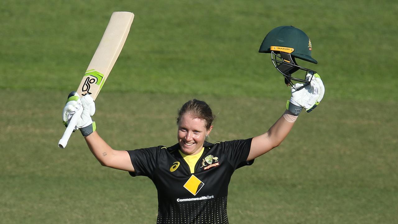SYDNEY, AUSTRALIA - OCTOBER 02: Alyssa Healy of Australia celebrates scoring a century during game three of the Women's Twenty20 International Series between Australia and Sri Lanka at North Sydney Oval on October 02, 2019 in Sydney, Australia. (Photo by Jason McCawley/Getty Images)