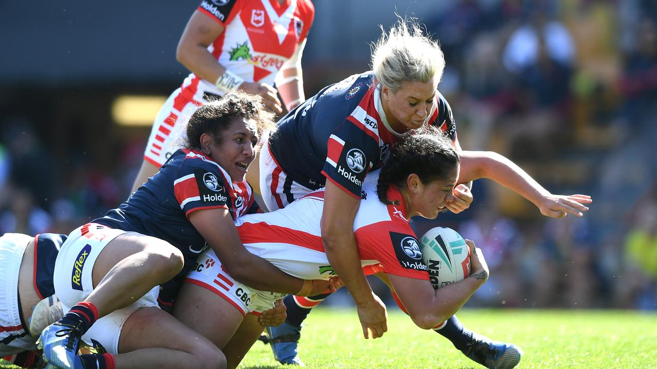 Ruan Sims taking down Najvada George at Leichhardt Oval last weekend. The Dragons won the game to advance into the grand final of the NRLW competition.