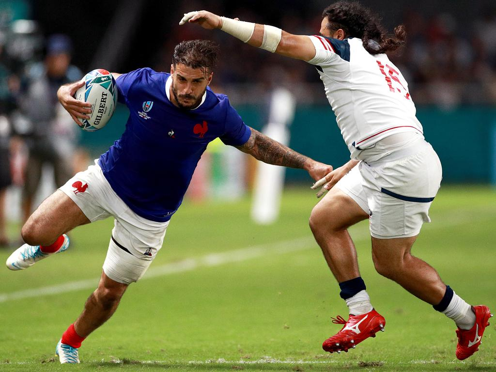 France centre Sofiane Guitoune looks to get past USA fullback Mike Te'o. Picture: Getty Images