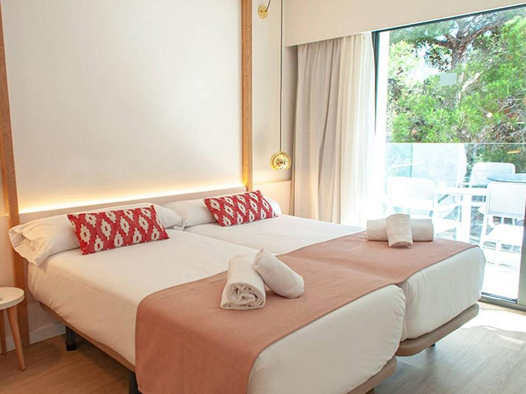 Double rooms contain single beds, which can be made into doubles on request. Picture: Som Dona Hotel