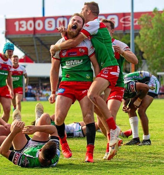 HIGH SPIRITS: Jordan Drew celebrating with his teammates from Wynnum-Manly Seagulls after winning the preliminary final against his former club, Townsville Blackhawks.