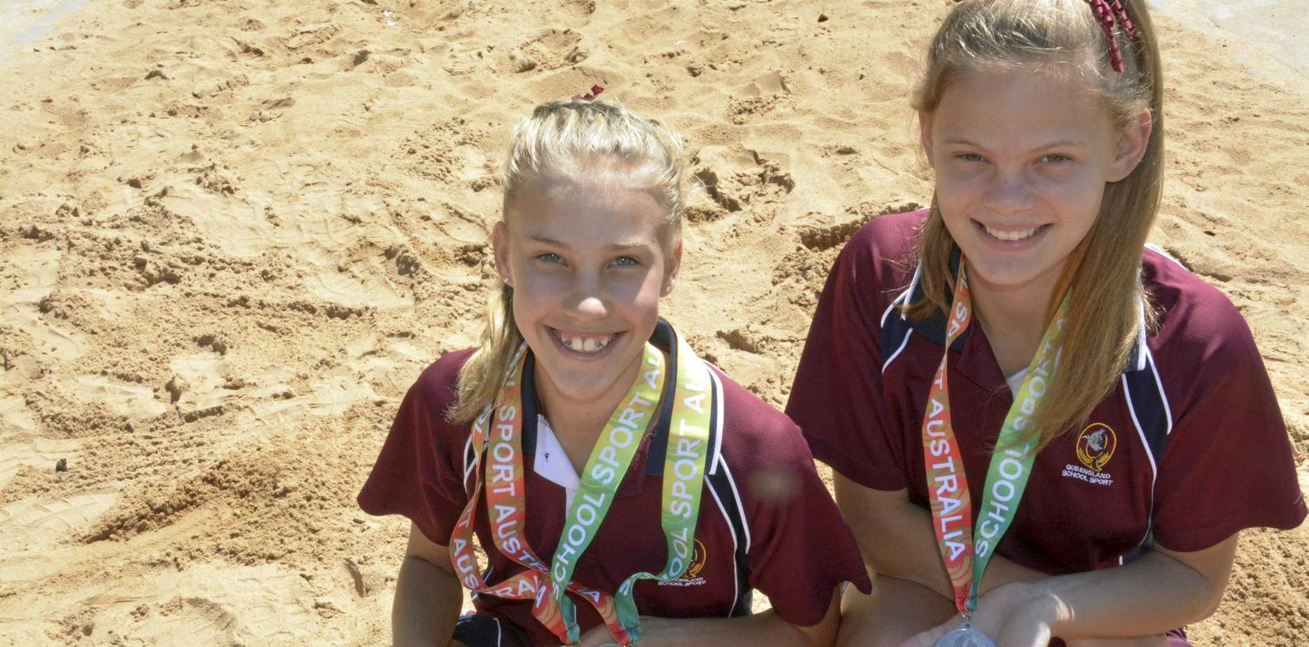 The Glennie School students Ruby Leicht (left) and Anna Park talk about their 1-2 long jump finish at the 10-12 School Sport Australia Track & Field Championships in Darwin. Ruby finished first ahead of friend Anna.
