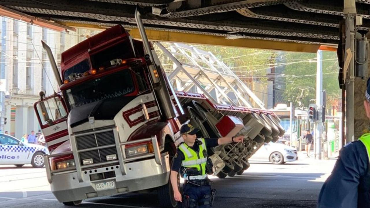 A truck became wedged under a bridge.