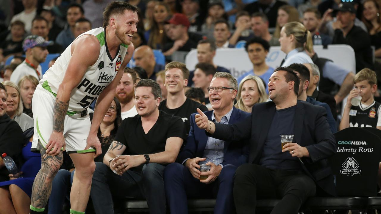 Creek shares a laugh with fans during the NBL opener. Pic: Getty Images
