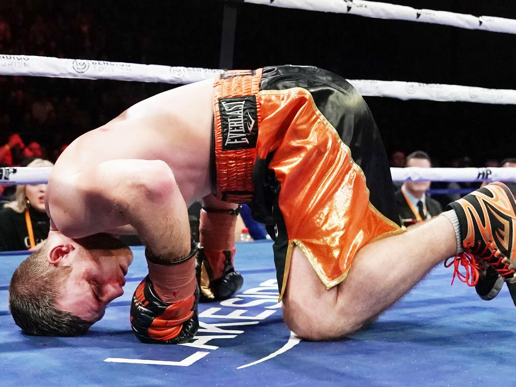Jeff Horn hits the deck against Michael Zerafa. (AAP Image/Michael Dodge)