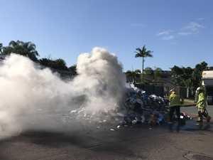 Smoke billows as fireys, neighbours battle rubbish blaze