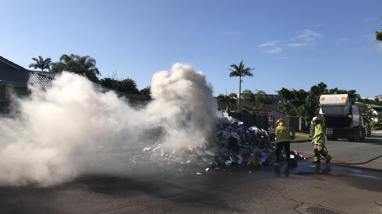 A large pile of rubbish caught on fire at Little Mountain this morning. Photo: Paul Bartolo