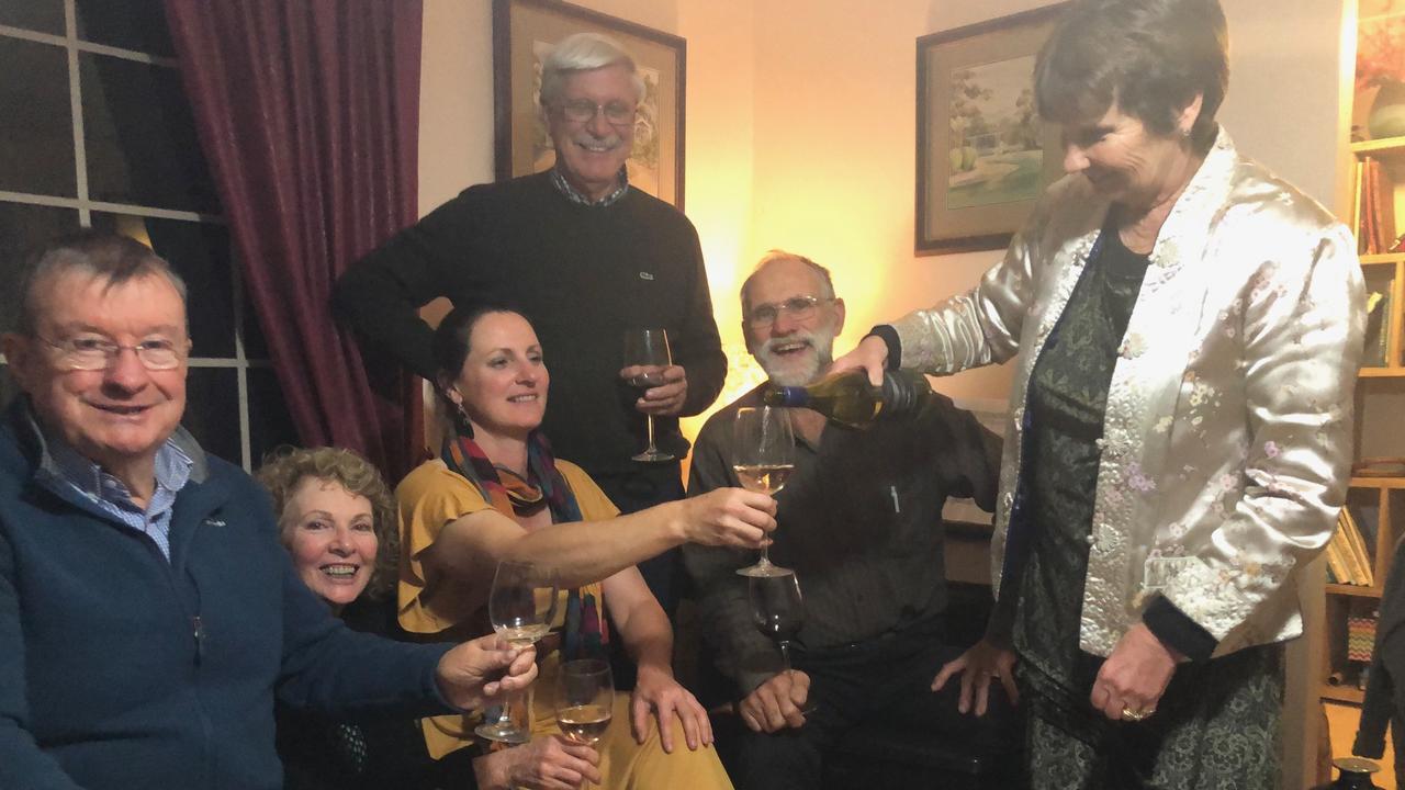 Colleen Willis is pouring wine for (from left) Peter Whitelaw, Ruth Whitelaw, Morwenna Harslett, Roger Willis and Alec Harslett.