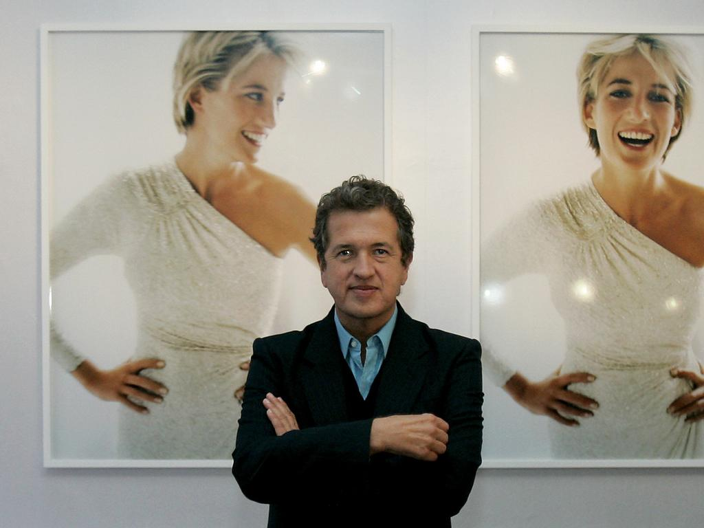 Peruvian photographer Mario Testino in front of his photographs of Diana, Princess of Wales at exhibition of his work at Kensington Palace in London 2005.