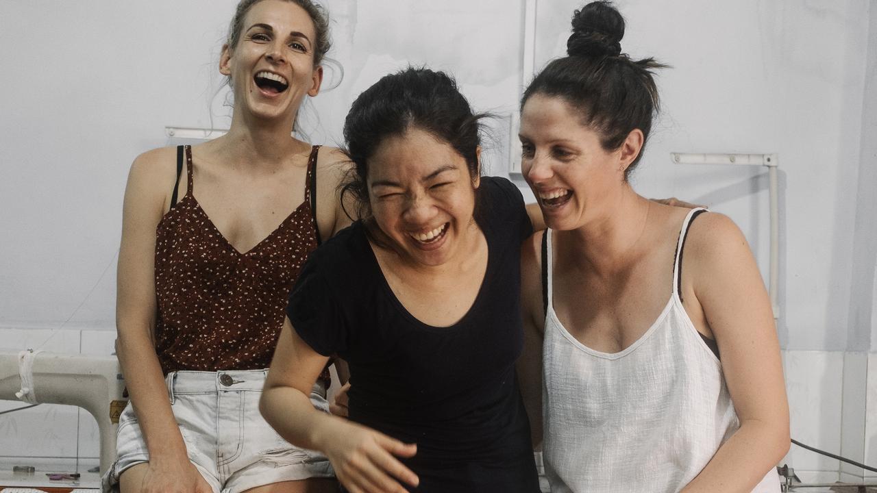 Nicki Edmiston (left), head seamstress Suong Thi Ngoc Nguyen ('Men') and Janelle Rawlins, of Noosa-based boutique and fashion label, The Travelling Kimono.