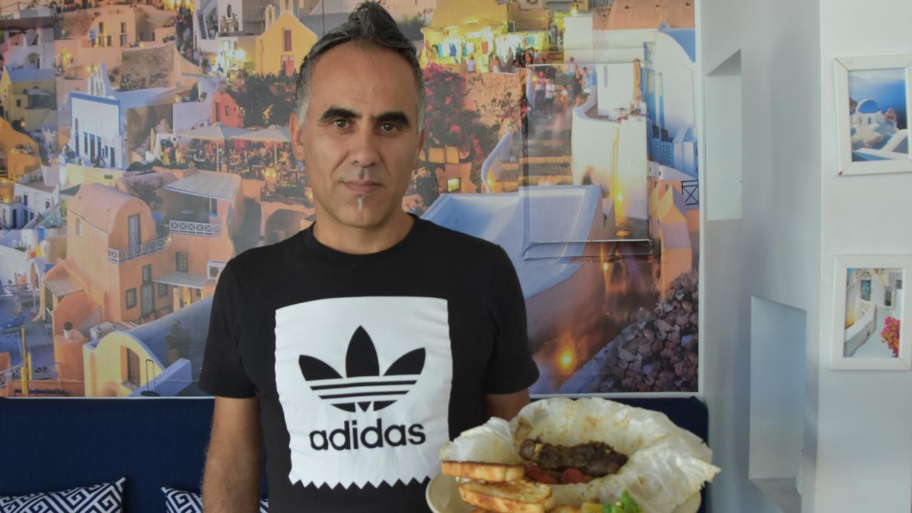 Yianis Kotrotsios servesa lamb kleftiko from Santorini Noosa Greek Taverna, ranked on TripAdvisor the best Greek restaurant on the Sunshine Coast. Photo: Caitlin Zerafa