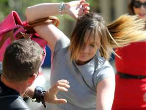 Woman charged with assault over court media brawl