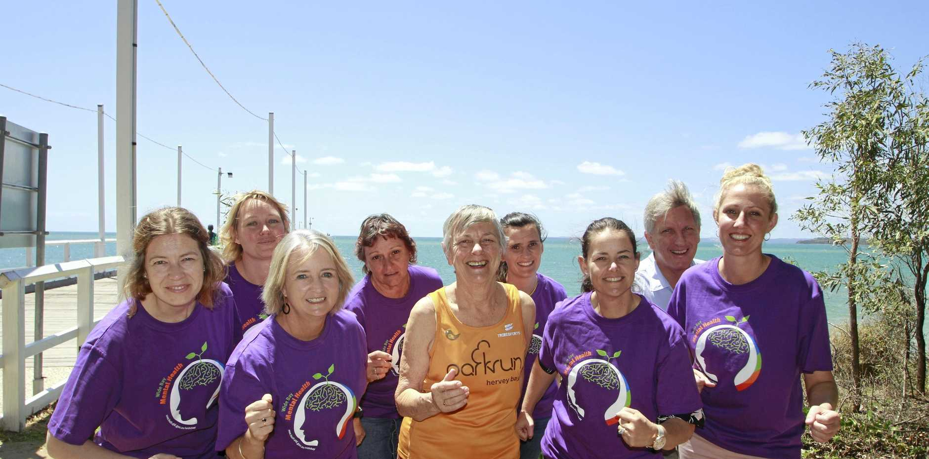 HEALTHY MINDS: The Urangan Pier will host one of many fun activities as part of Queensland Mental Health Week, with Alida Connell, Elnike Brand, Ruth O'Sullivan, Di Desousa, Stacey Cooper, Bill Rostedt, Amii Gardiner, Lyle Gronow and Fiona Prescott getting ready for the 5km walk/run with community group, parkrun.