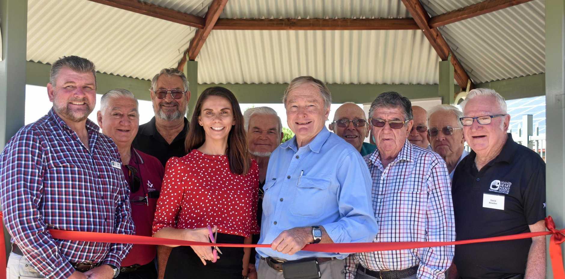 Gary Mark, CEO of Hand Heart Pocket, Melanie Calvert, CEO of Pinaroo, Howard Hobbs, Chairman and members of Roma Freemasons at the opening of a newly landscaped garden at Pinaroo.