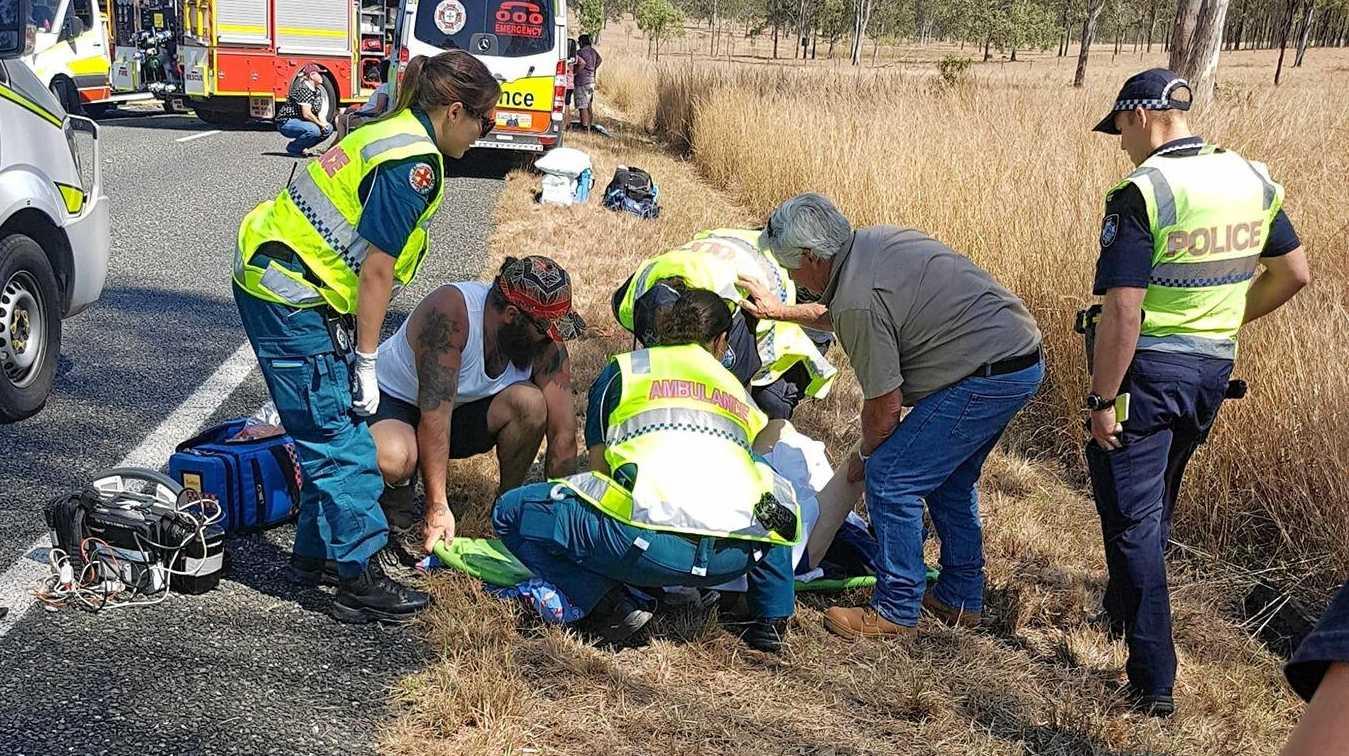 HEROIC EFFORT: Josh Morris and another civilian help emergency services at the Kilkivan crash.