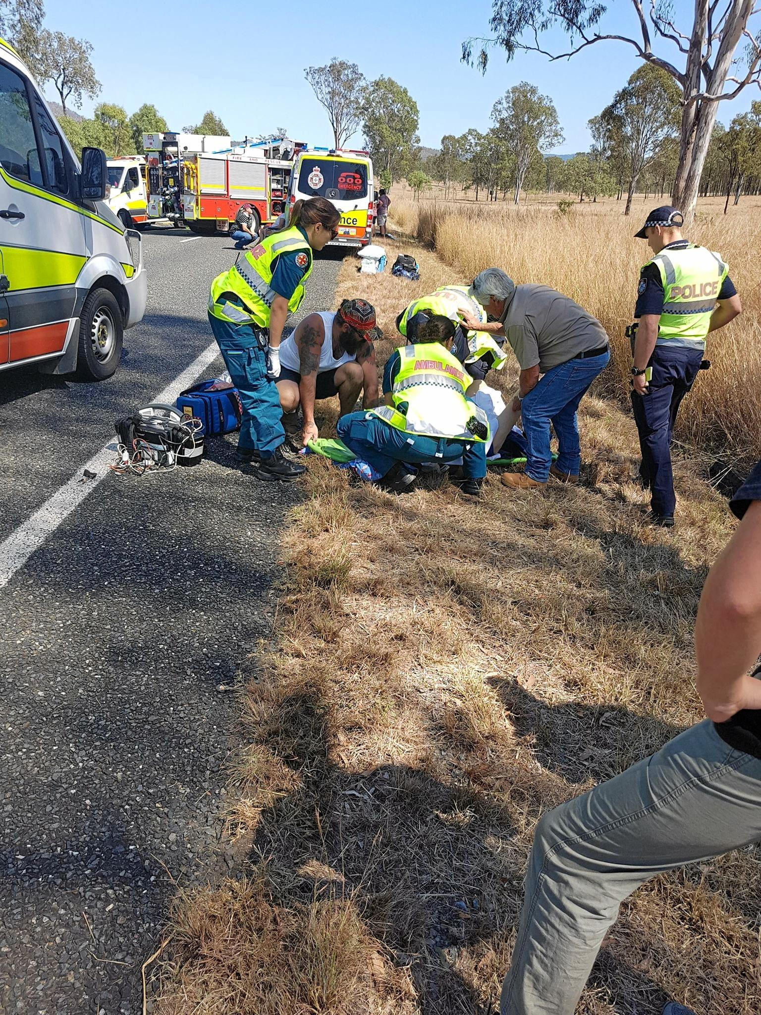 HEROIC EFFORT: Josh Morris and another civilian help emergency services at the Kilkivan crash.