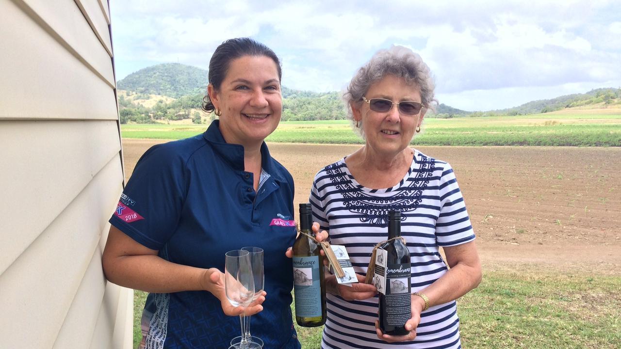 Palmina Rae and Joy Muller proudly show off the Habana Church Commemorative Wine.