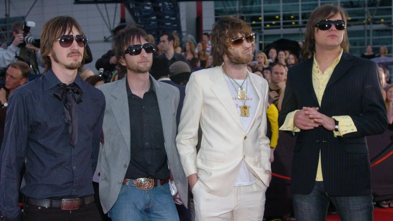 Cameron Muncey, brothers Nic & Chris Chester, and Mark Wilson from the band Jet arrive at the Aria Awards in 2004. The band has cancelled their Caloundra Music Festival Show at the last minute.