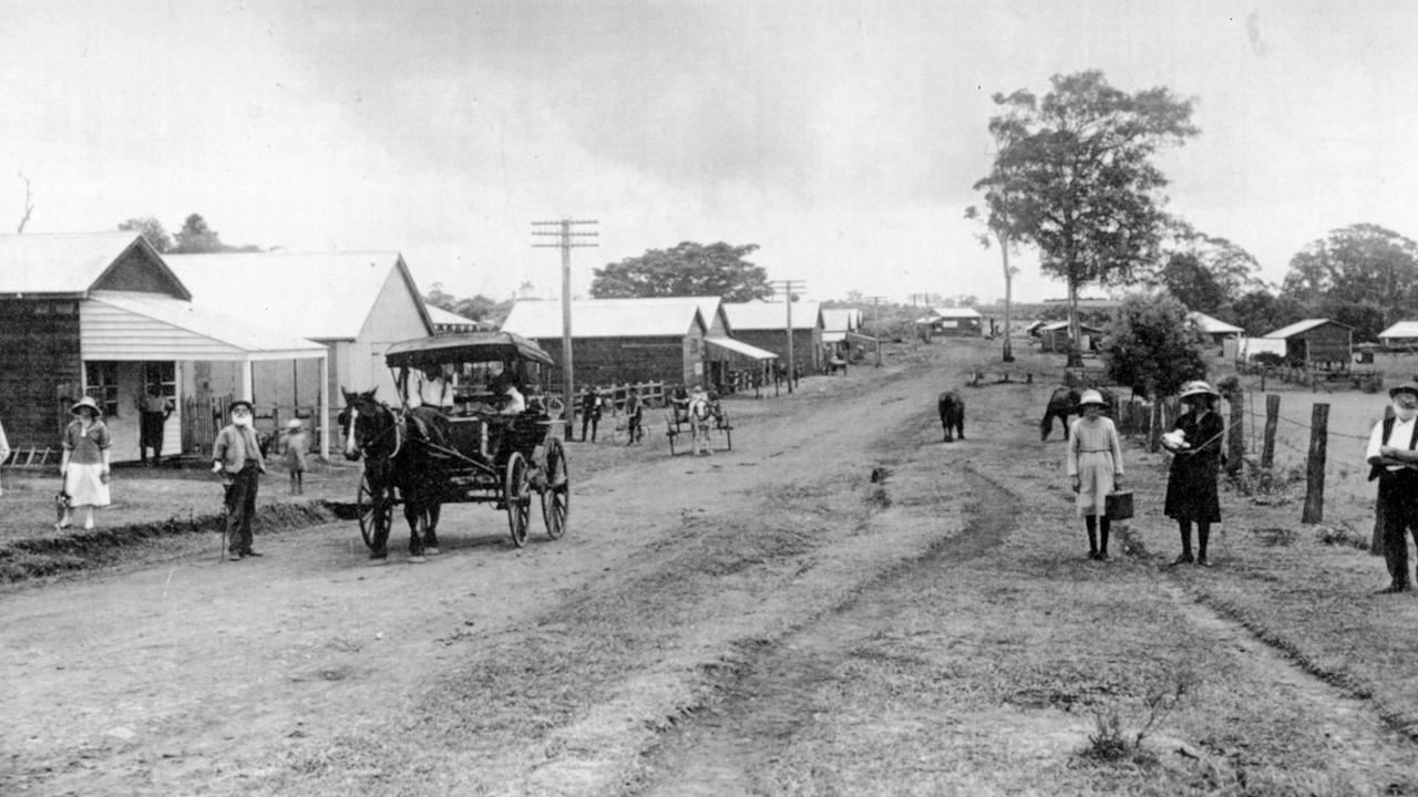 Main Street, Buderim looking west, when vehicular traffic was carts, buggies and bicycles, 1916. Buildings pictured (from left): Bill Mitchell's Butchers Shop; Case Making Factory (previously a Blacksmith's and later the site of Buderim's first Ginger Factory); Stan Burnett's Carrying Business and Billiard Room (later Ernest Middleton's second shop); Ernest Middleton's first store and tearooms; B