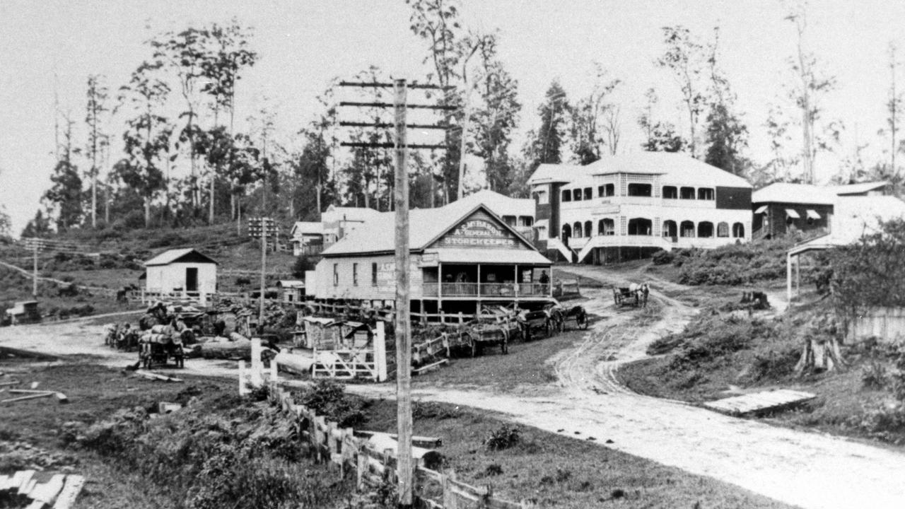 The main street of Palmwoods looking south towards Palmwoods Hotel, 1917. Pictured: Palmwoods Railway Yards, A.S. McBaron's General Store and the Palmwoods Hotel.