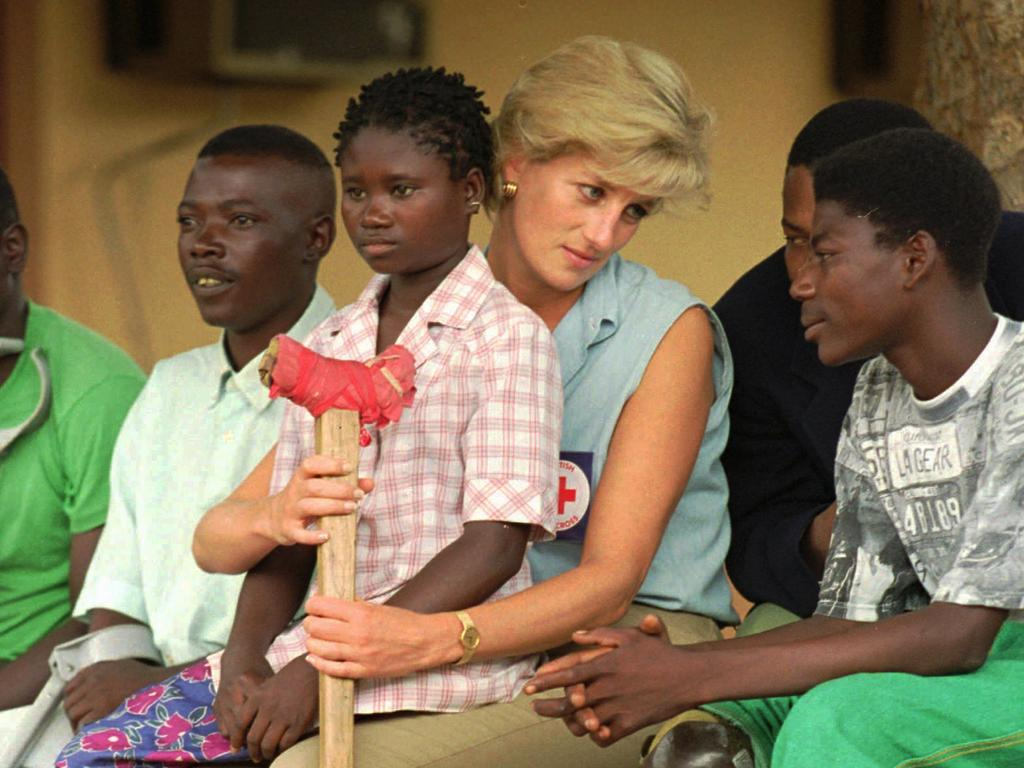 Princess Diana talks to amputees, at the Neves Bendinha Orthopedic Workshop near Luanda, Angola, which Prince Harry also visited 22 years later. Picture: AP Photo/Joao Silva, File.