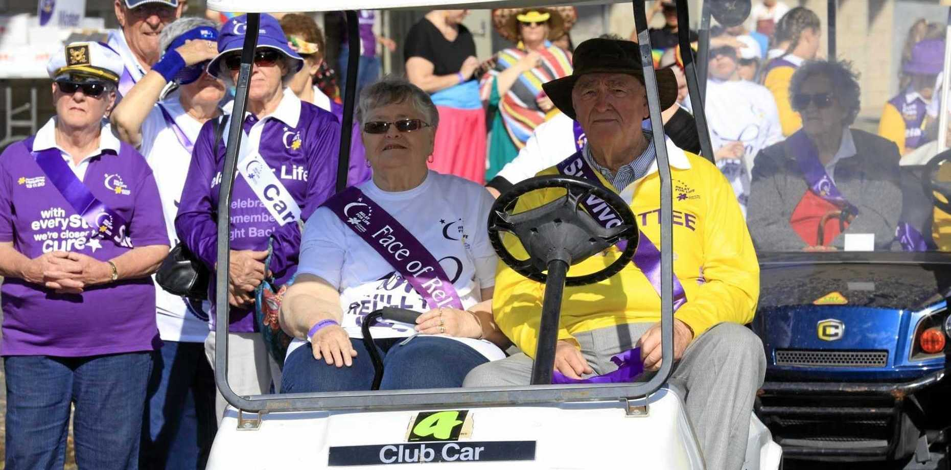 Survivors and carers lead the way at the Dalby Relay for Life last year.