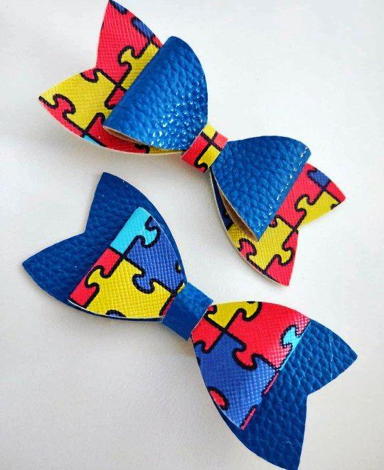 Raquel Strange through her So Bella Bow's has created an autism awareness bow for her son Aidan who is on the spectrum.