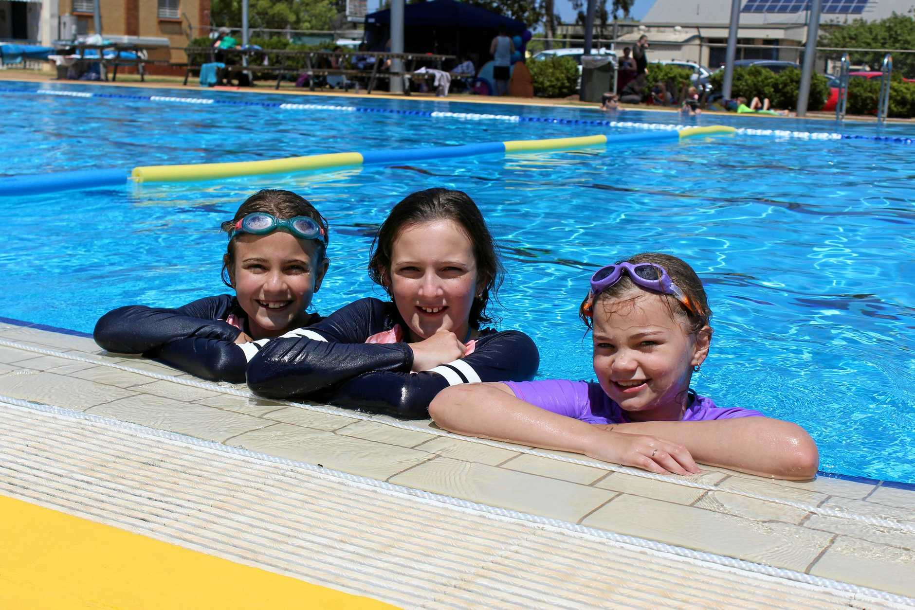 FUN WITH FRIENDS: Amelia and Madison Postlethwaite along side Lydia Koy at the family fun day at Kingaroy Aquatic Centre.