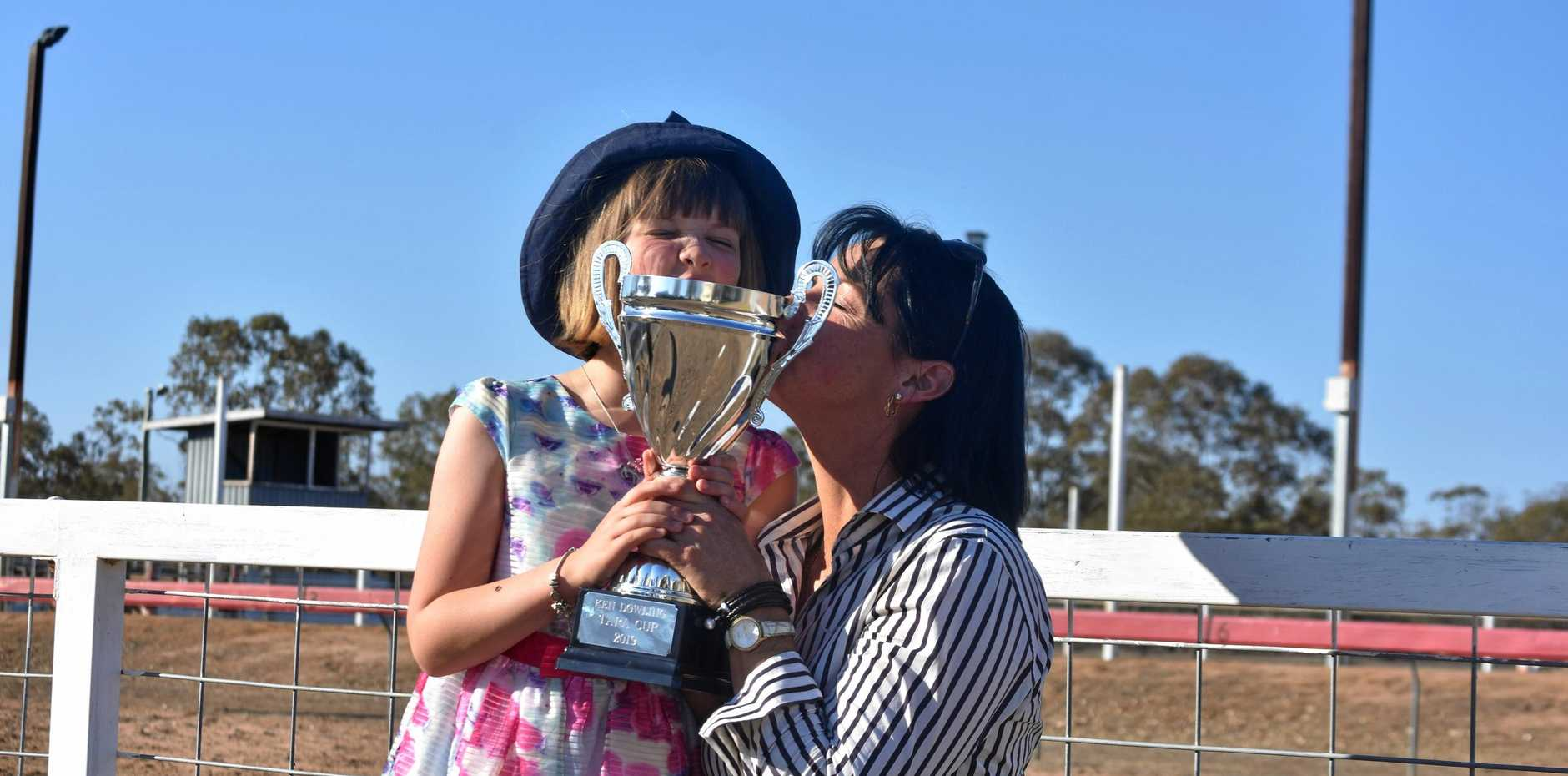 FOR DAD: Jorja Crompton and her mum Jackie with the Ken Dowling Cup, named in memory of Jackie's late father.