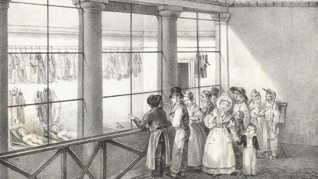 People visiting the morgue in Paris to view the cadavers.