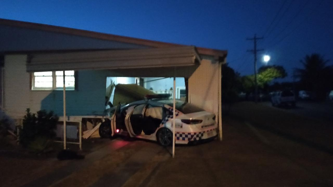 A police car crashed into a North Mackay home on the corner of Malcomson St and Corney St in the early hours of Saturday.