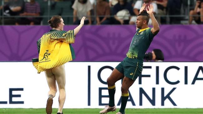A streaker offers a high five to Kurtley Beale, who wants no part of it. Picture: Getty Images