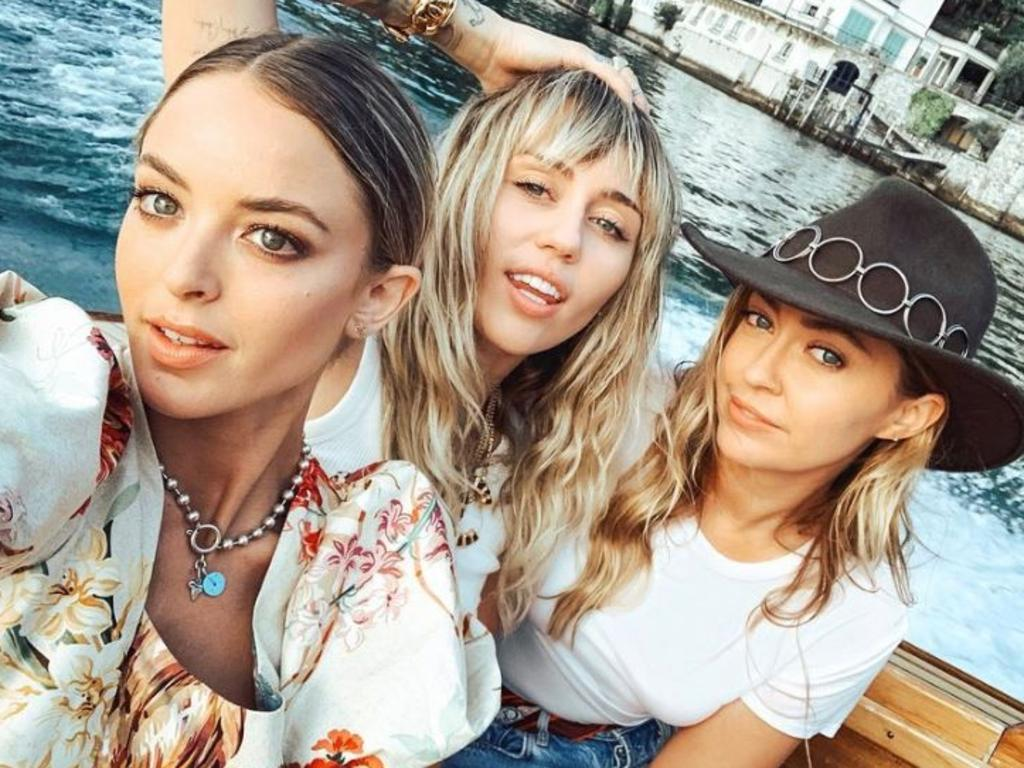 Miley Cyrus and Kaitlynn Carter (pictured left) were seen kissing while on holiday in Italy with Brandi Cyrus (right). Picture: Instagram