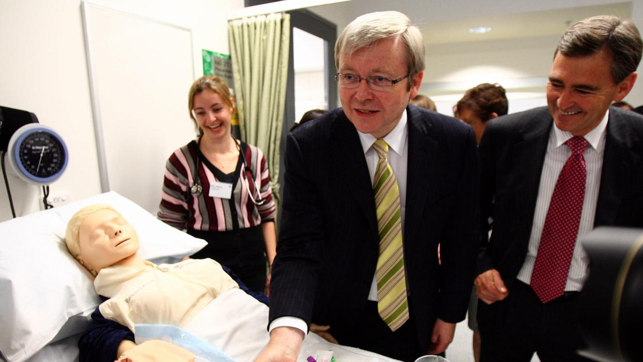 Former prime minister Kevin Rudd with a Resusci Anne mannequin.