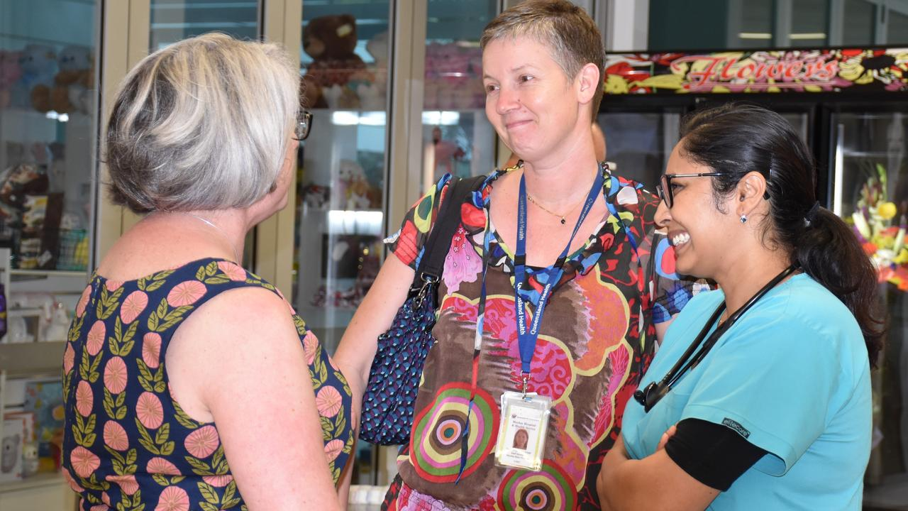 Shark attack survivor Justine Barwick speaks with Mackay Base Hospital's Dr Wendela Schimmer and Dr Tina Moriaty, who were among the team involved in saving her life and leg.