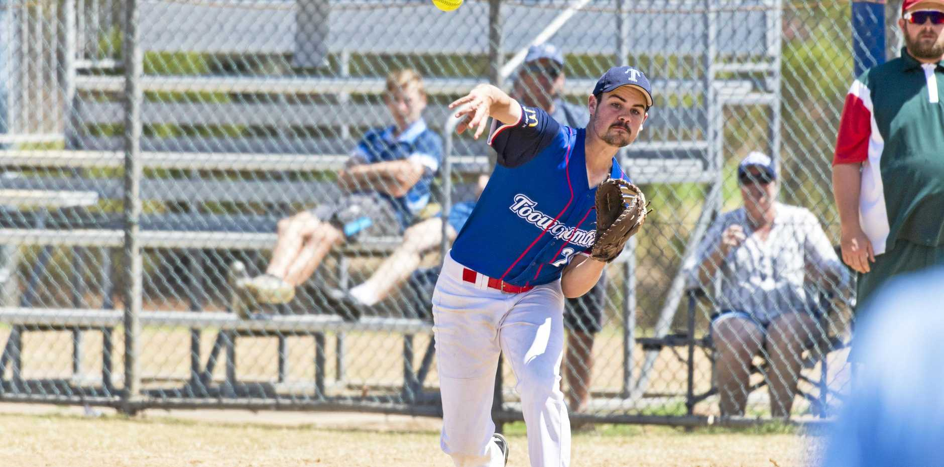 ON BASE: Toowoomba's Rohan Doherty fires off a throw during his side's Queensland under-18 men state championship final against Redlands at Kearneys Spring Sporting Complex.