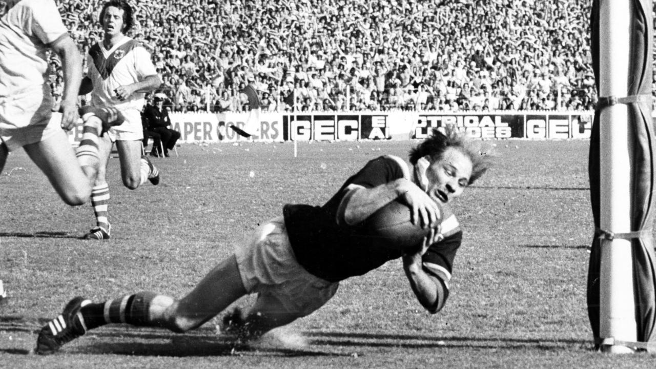 Johnny Mayes dives over to score a try during Easts premiership win in 1975 against St George.