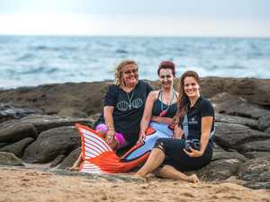 Rare sighting: Mermaids sunning on beach aid breast cancer