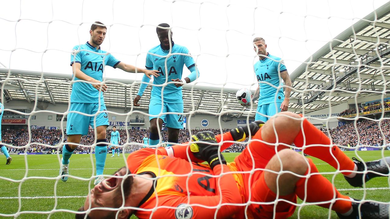 Spurs players rush to aid a stricken Hugo Lloris.