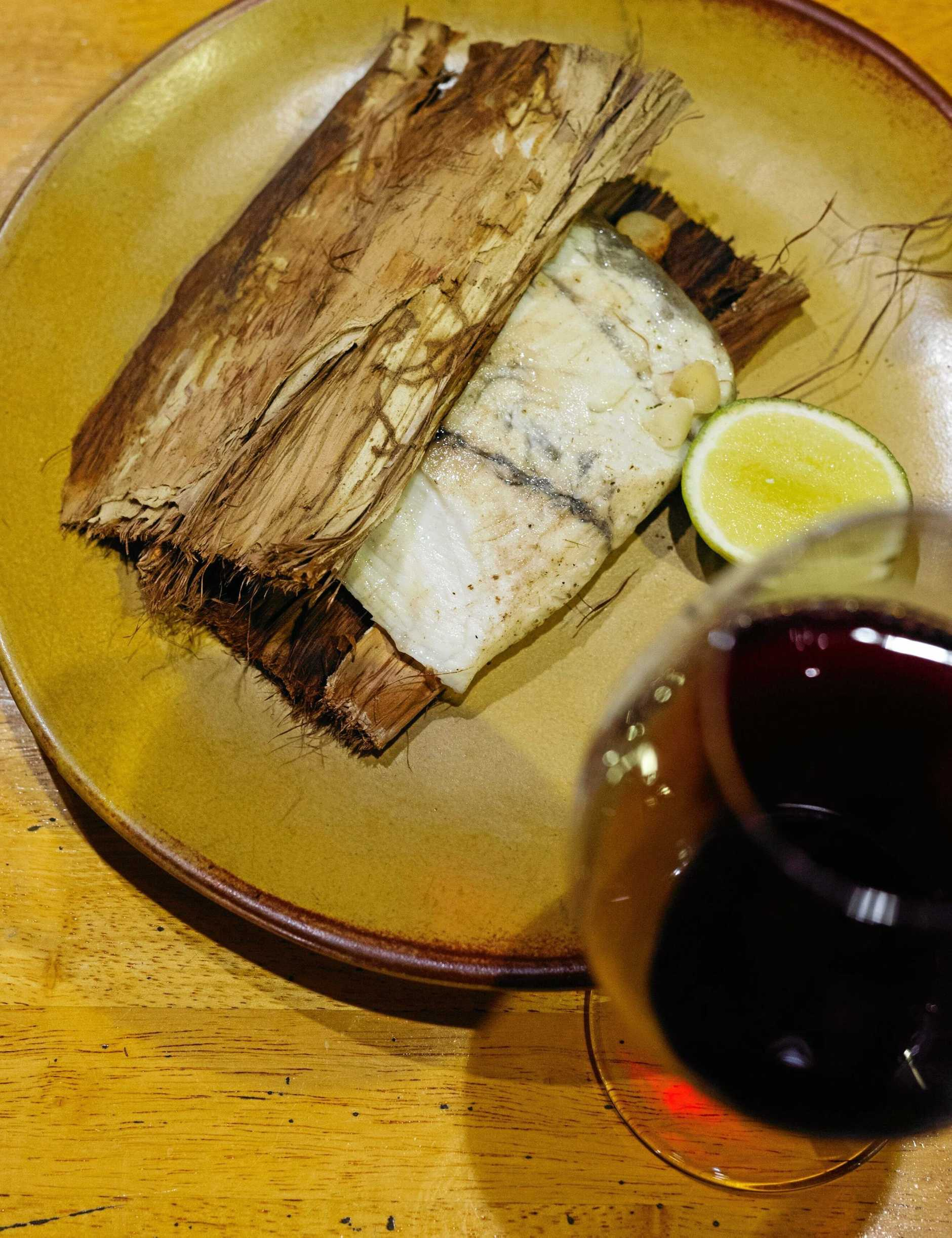 Seabelle Restaurant's signature dish: paperbark-wrapped North Queensland barramundi. Picture: Kingfisher Bay Resort