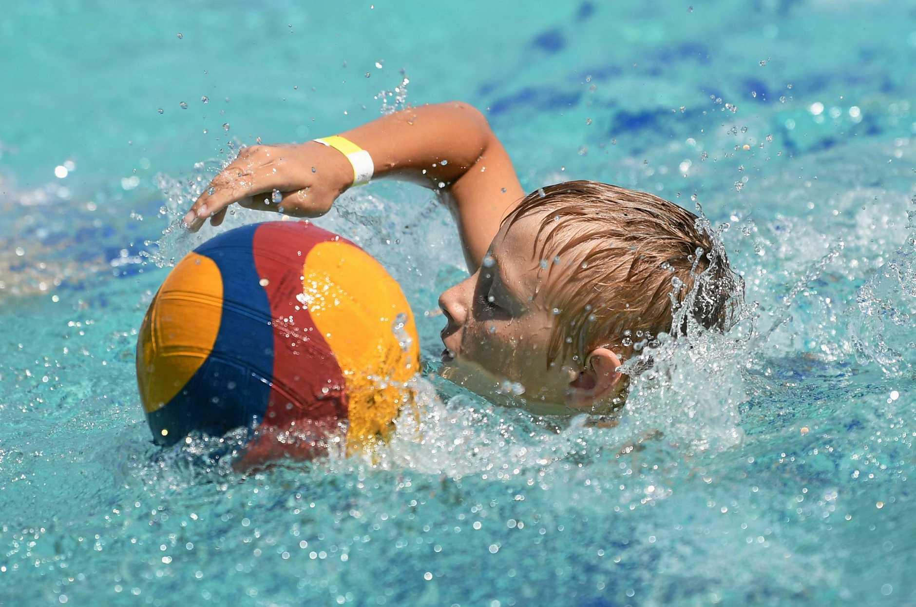Water Polo clinic - Riley Hancock dribbling the ball.