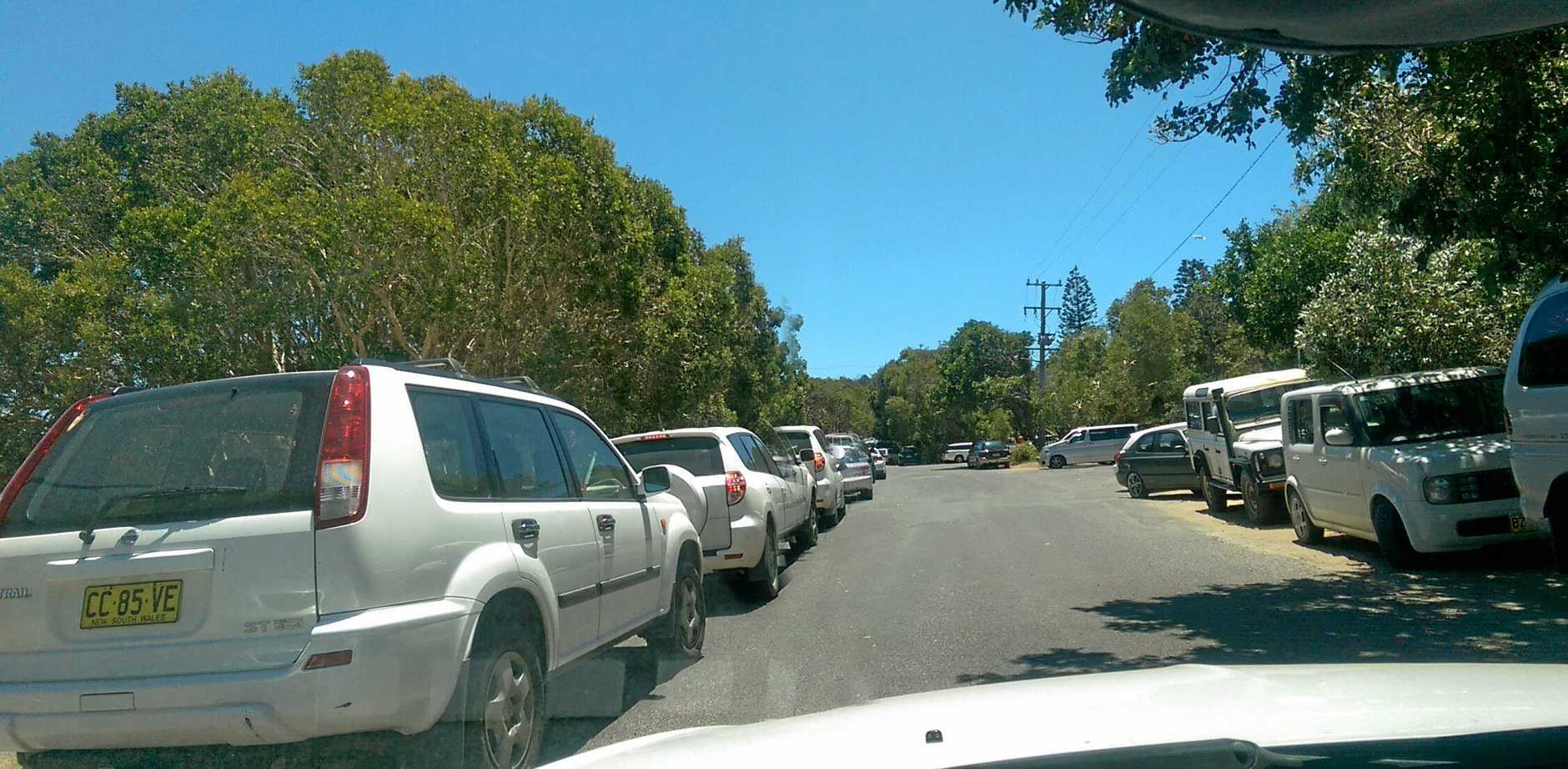 Ballina Shire Council will prepare a report on options to prevent guests at the Lennox Head caravan park taking up the public car parking spaces near Lake Ainsworth.